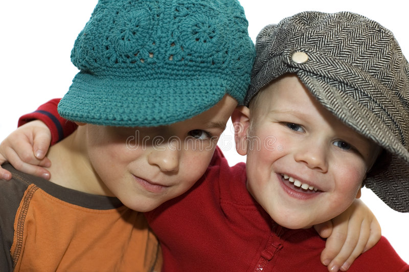 Two lovely brothers. With hats royalty free stock photo