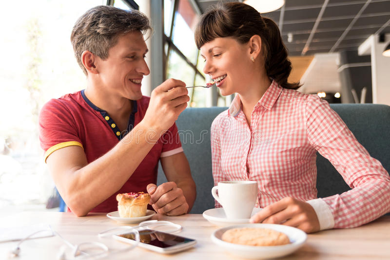 Two Lovers Chatting And Having Fun In The Cafe Stock Image