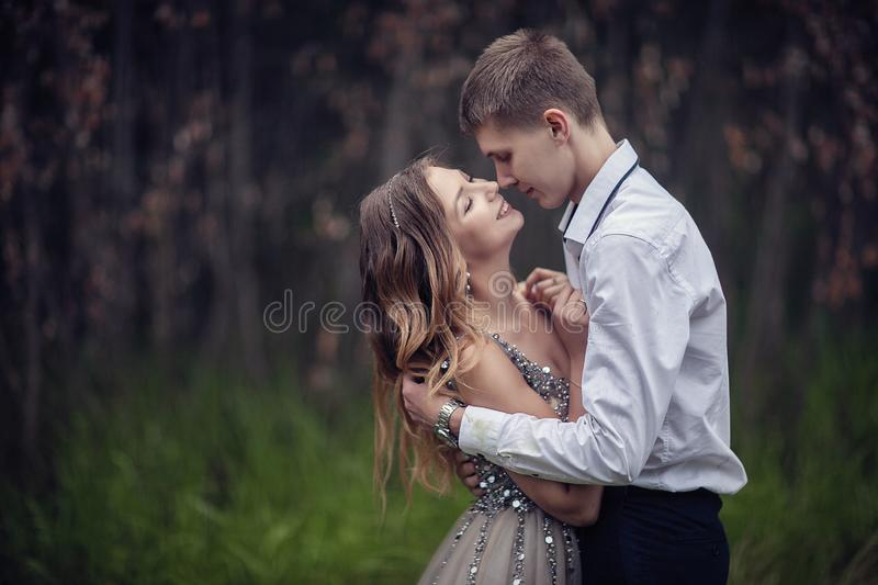 Two lovers in the forest. Photoshoot in the rainy forest royalty free stock photos