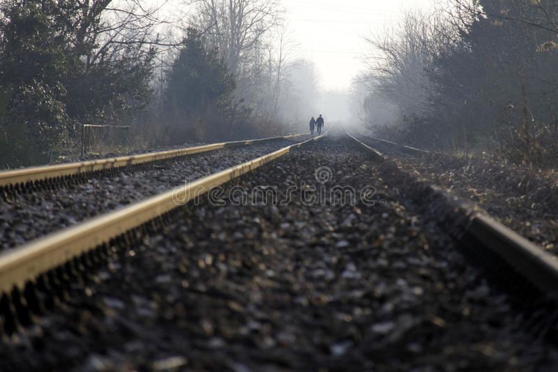 Download Two Lovers Holding Hands Walking On The Train Tracks Stock Photo - Image: 29503264