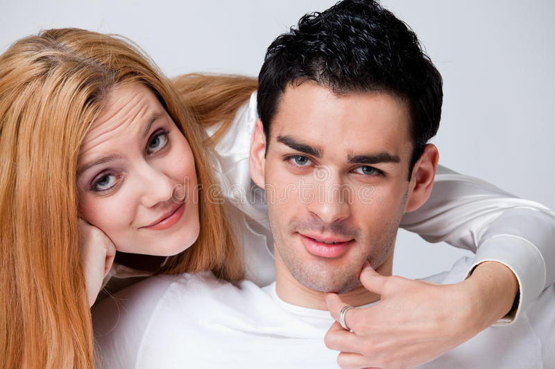 Two lovers in romance. Two lovers with a tight relationship together at home watching TV royalty free stock images