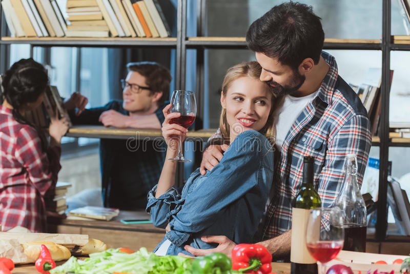 Two loving couples resting in room stock images