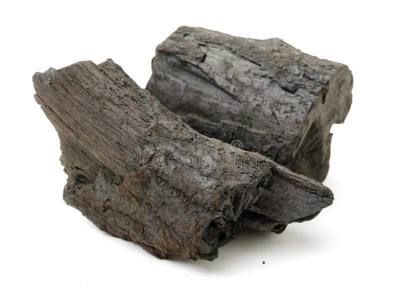 Two Lump of charcoal made of wood. Isolated on white background stock photos
