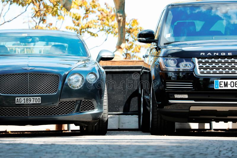 Two Luxury English Cars Parked in a Parking Lot royalty free stock photos