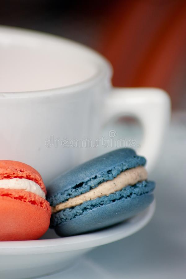 Two Macarons and a Coffee Mug royalty free stock photo