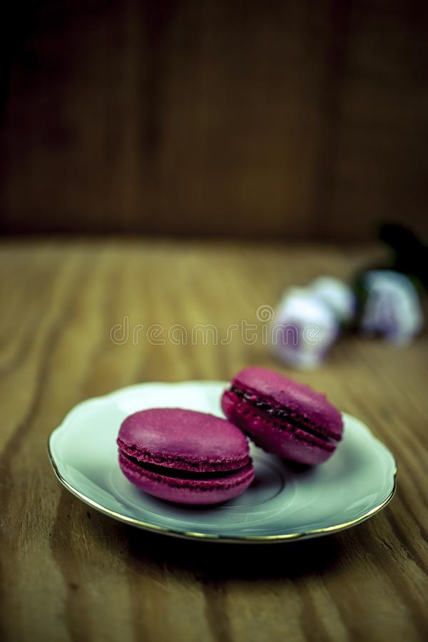 Two pink macaroons with flowers stock photos