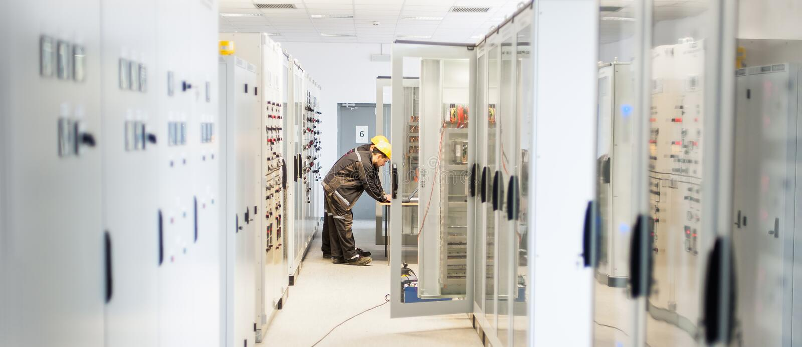 Two maintenance engineer work on relay protection system royalty free stock images