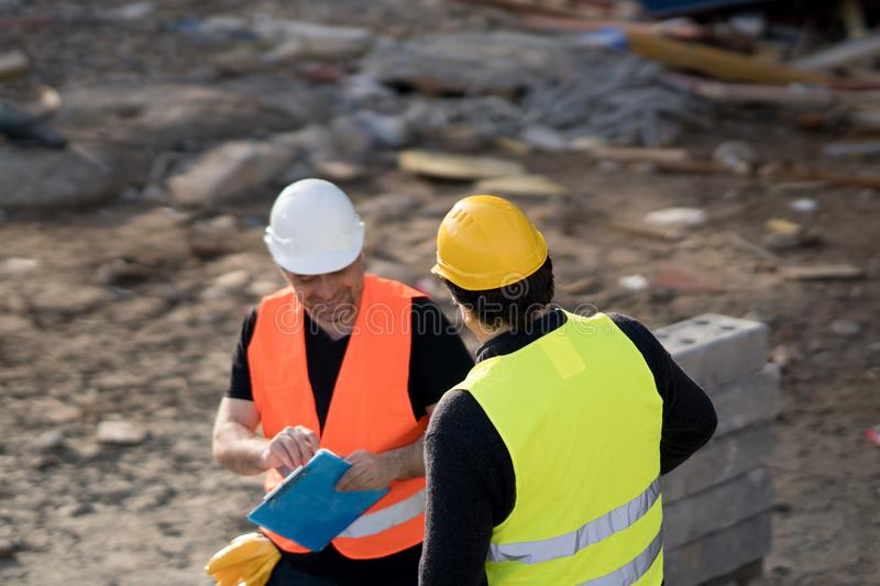 Two male civil engineers at work royalty free stock image