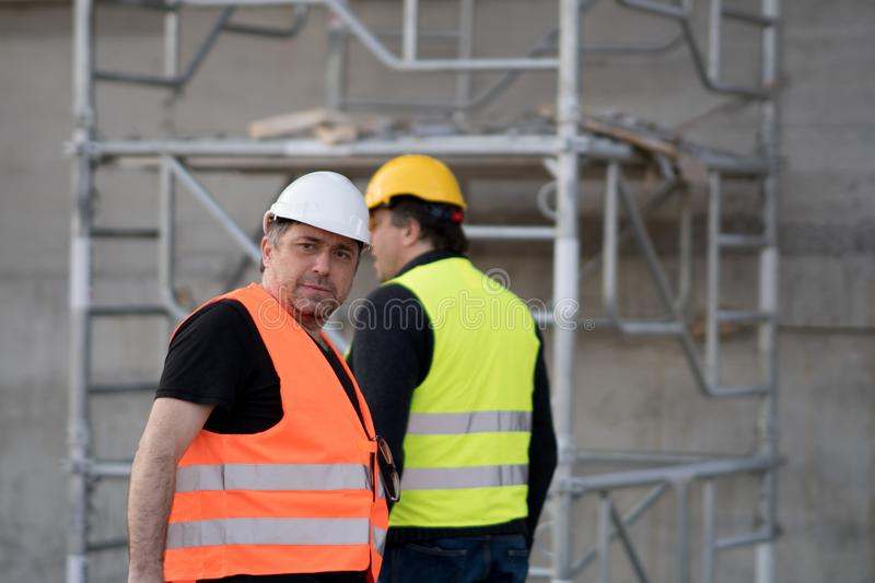 Two male civil engineers at work stock photo