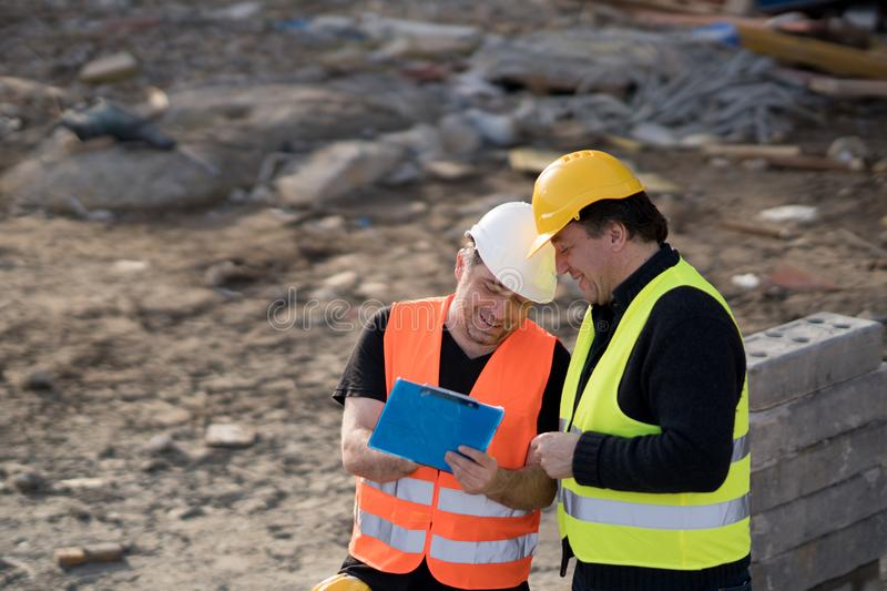 Two male civil engineers at work royalty free stock images