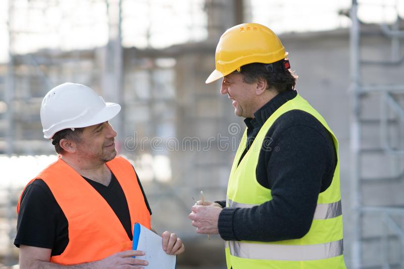 Two male civil engineers at work stock image