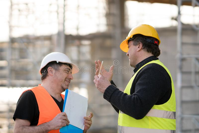 Two male civil engineers at work stock images