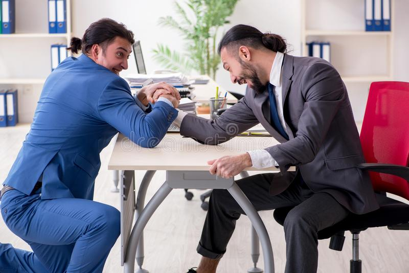 The two male colleagues in the office. Two male colleagues in the office stock image