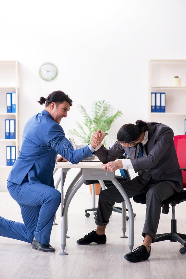 The two male colleagues in the office. Two male colleagues in the office royalty free stock images
