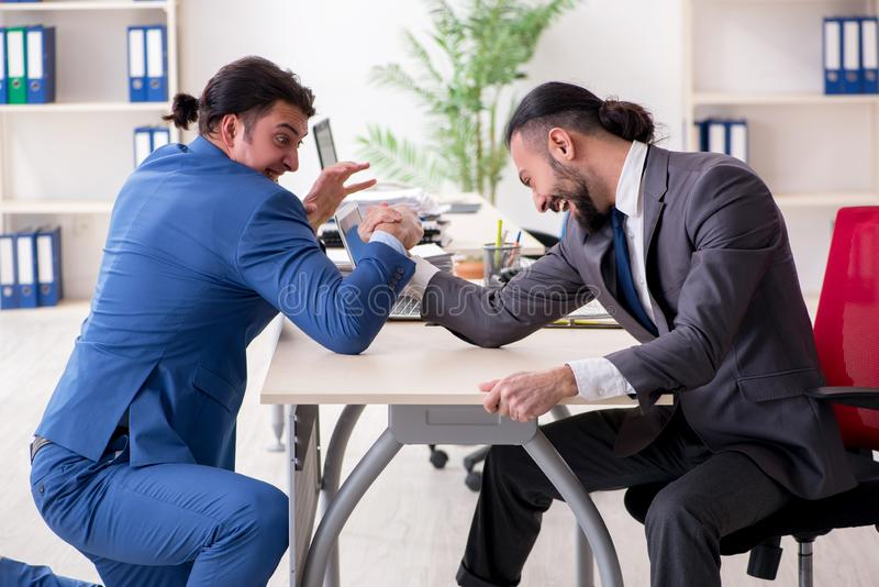 Two male colleagues in the office. The two male colleagues in the office royalty free stock photography