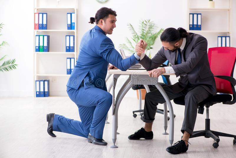 Two male colleagues in the office. The two male colleagues in the office stock photo