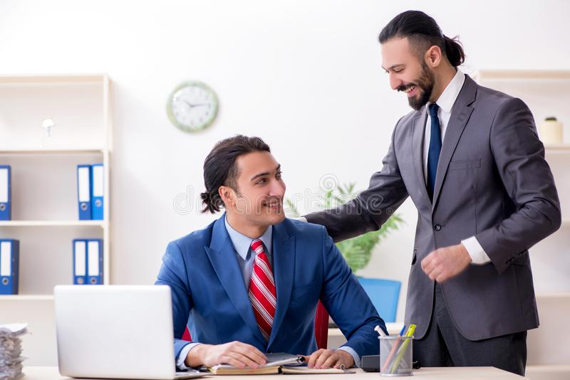 Two male colleagues in the office royalty free stock photos