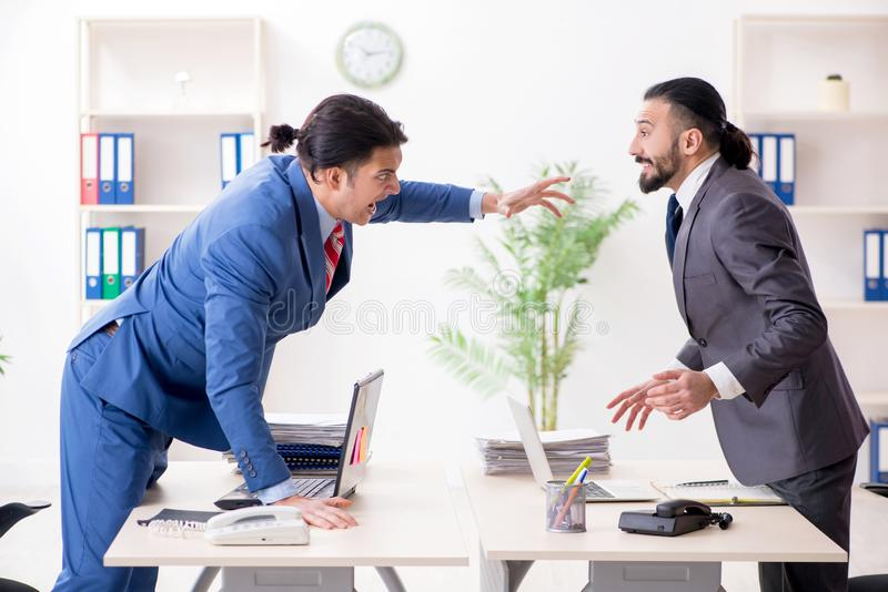 Two male colleagues in the office stock photo