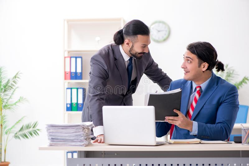 Two male colleagues in the office royalty free stock image