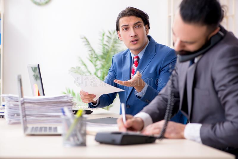Two male colleagues in the office royalty free stock photography