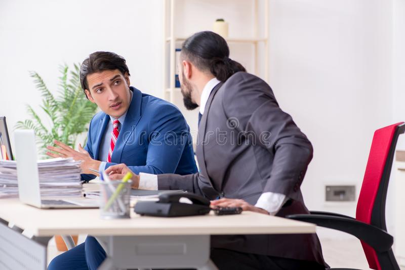 Two male colleagues in the office stock photos
