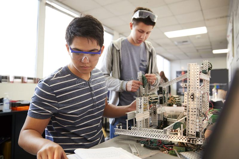Two Male College Students Building Machine In Science Robotics Or Engineering Class stock photo