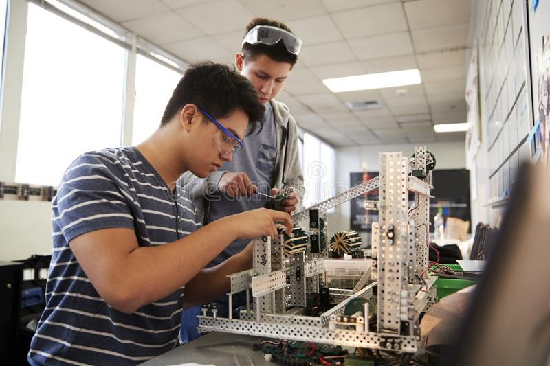 Two Male College Students Building Machine In Science Robotics Or Engineering Class royalty free stock images