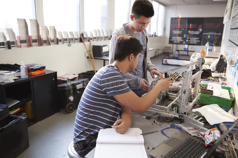 Two Male College Students Building Machine In Science Robotics Or Engineering Class royalty free stock photos
