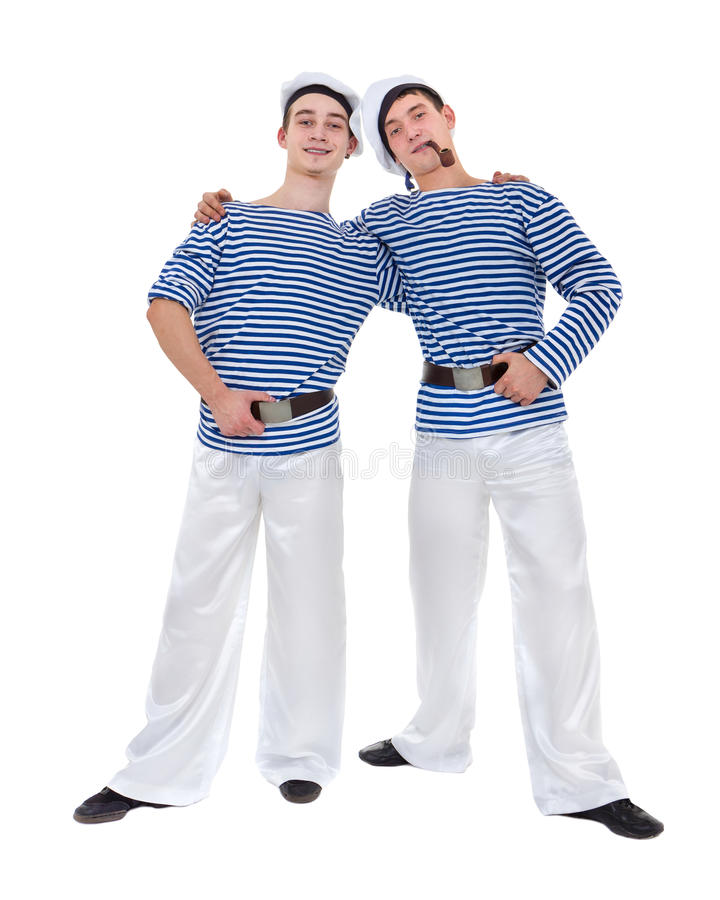 Two male dancers dressed as a sailor posing against isolated white in full length. royalty free stock photography