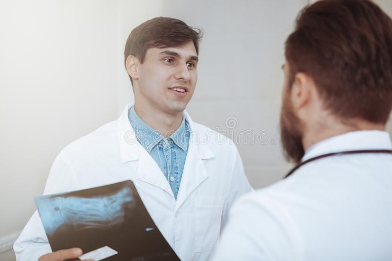 Two male doctors discussing x-ray scans at the hospital royalty free stock photos