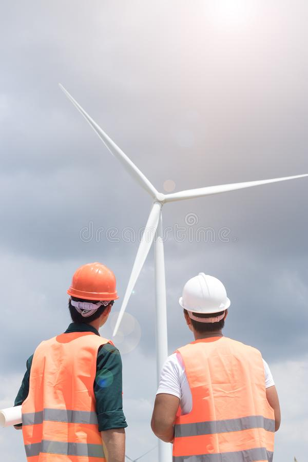 engineers are working at the wind turbine. royalty free stock image