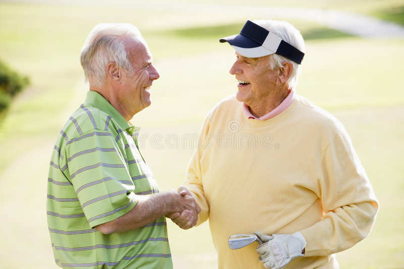 Download Two Male Friends Enjoying Game Of Golf Stock Photo - Image: 7230834