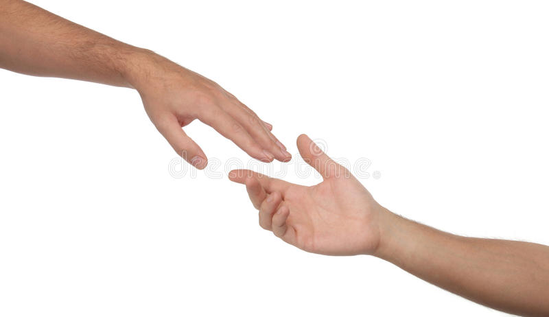 Two male hands reaching towards each other. Isolated stock photo