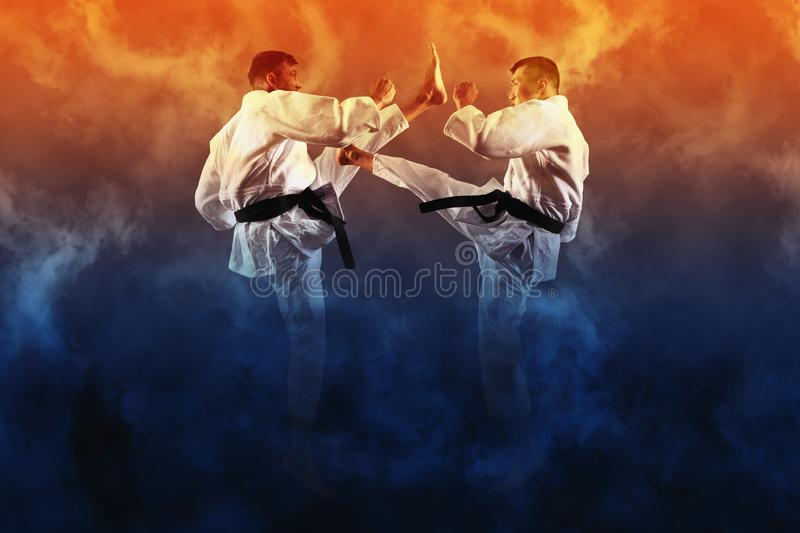Two male karate fighting royalty free stock photos