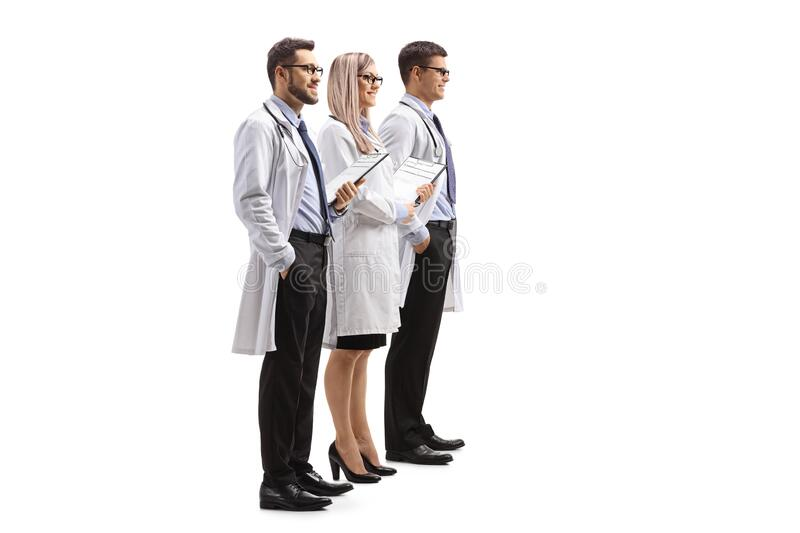 Two male and one female doctor stock photography