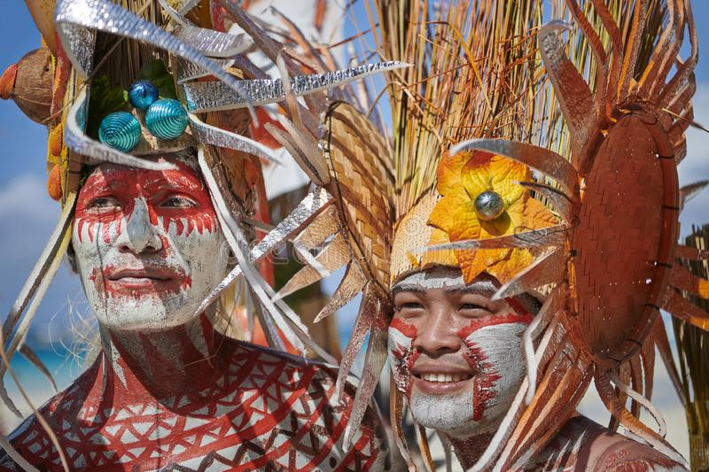 Two male participants at the Ati-atihan Festival on Boracay Island. The traditional catholic Ati-Atihan Festival parade is held in honor of the Santo Niño stock photography