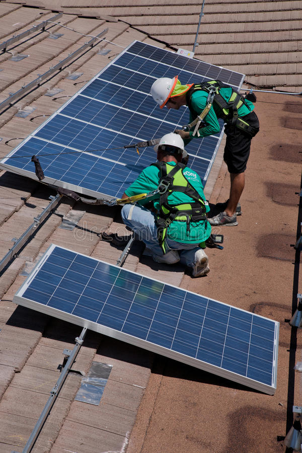 Free Two Male Solar Workers Install Solar Panels Royalty Free Stock Images - 35488929