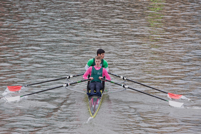 Two Man Crew Rowing Hard. BRISTOL, ENGLAND - FEBRUARY 19: Two man crew pulling hard in the annual Head of the River race in Bristol, England on February 19, 2012 royalty free stock photos