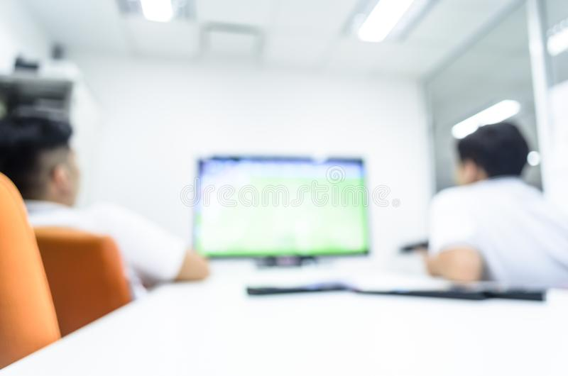 Two man has watching fooball via television on break time and re royalty free stock image