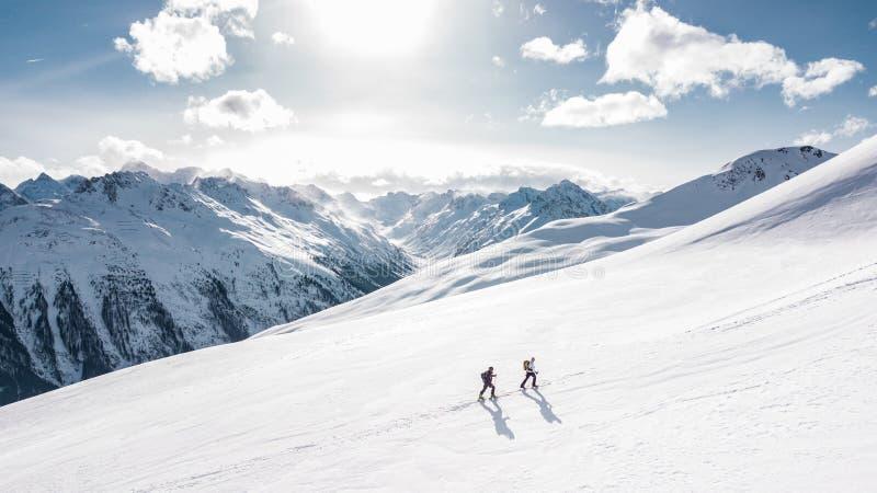 Two Man Hiking on Snow Mountain stock image