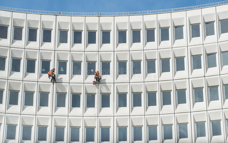 Two man rappelling from the wall for fix the damaged building in Christchurch, New Zealand. Christchurch is the largest city in the South Island of New Zealand royalty free stock photo