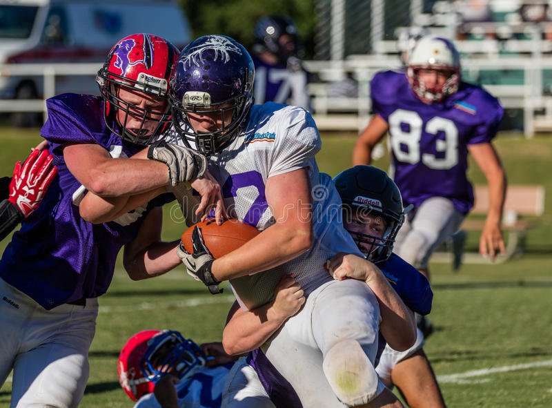Two Man Takedown. Football action at the Lion's All Star game in Redding, California royalty free stock photography