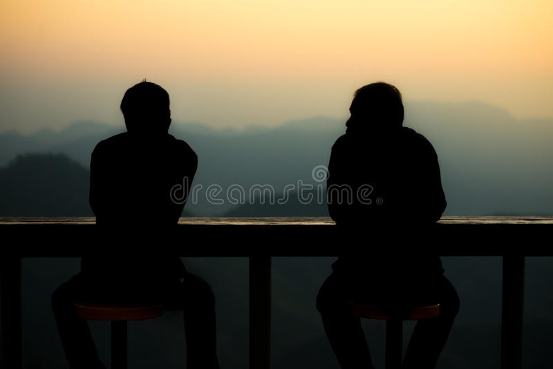 Two man talking each other. Silhouette two man talking each other in the morning stock photos