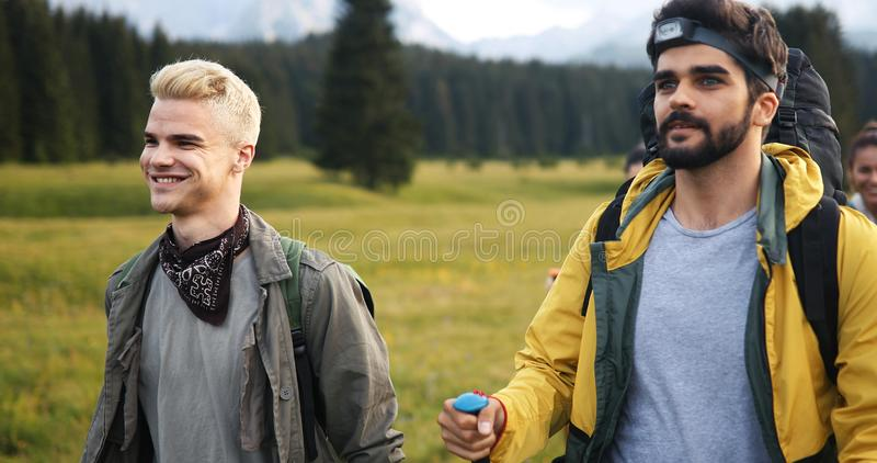Two man traveling in a mountains staying on footpath relaxing and enjoying the wiew royalty free stock image