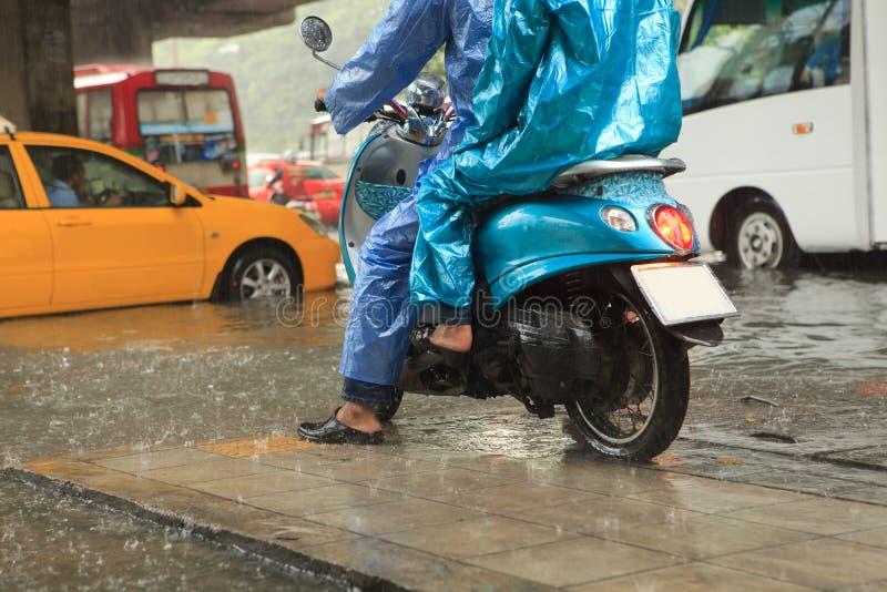 Download Two Man Wearing Raincoat Riding Motorcycle Stock Image - Image: 33639845