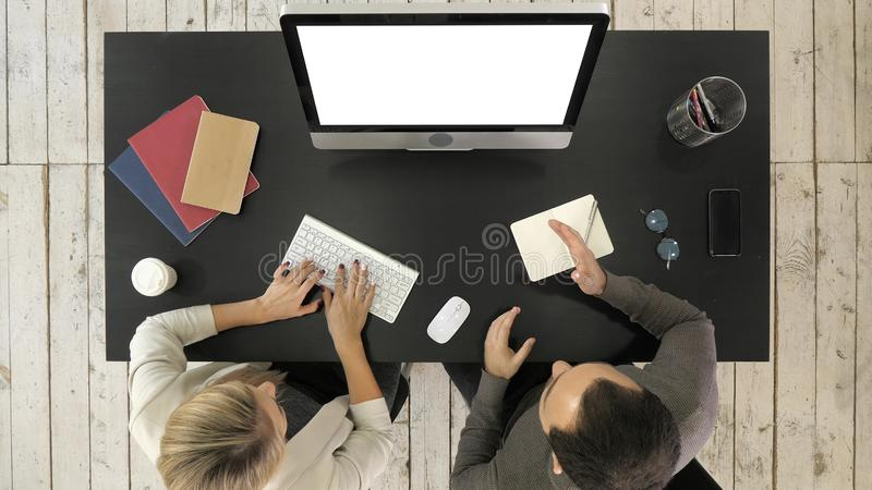 Two managers working discussing project on the screen of computer. White Display. stock photo