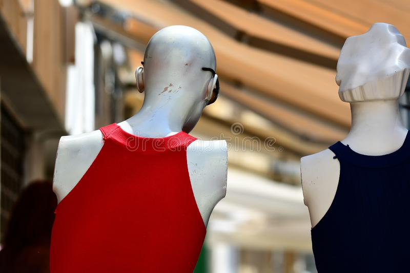 Female manequins in street fashion shop. Two manequins croped and shot from the rear , that is from behind in a street fashion show, . all two dolls are stadning stock photo