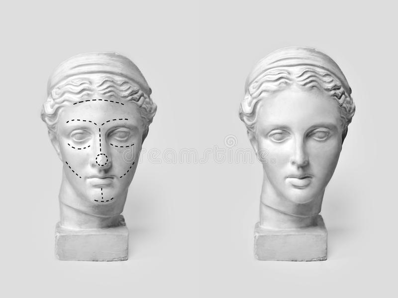 Two marble heads of young women, ancient Greek goddess bust marked with lines for plastic surgery and sculpture after. Operation on light background. Old and stock images