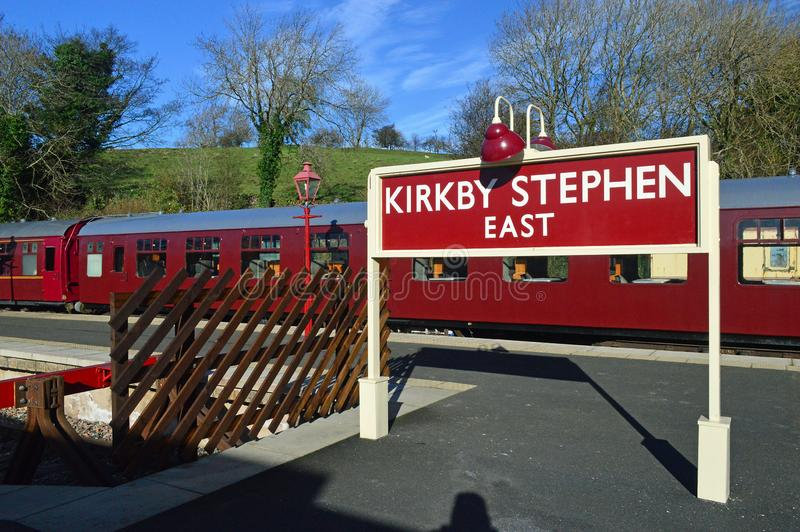 Platform sign and coaches kirkby stephen east station royalty free stock photography