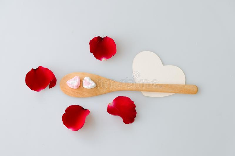 Two marshmallow shape heart on wood spoon royalty free stock photos